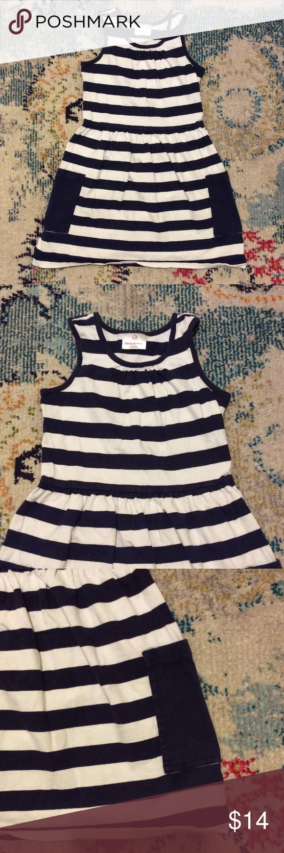 Hanna Andersson Navy Striped Jumper Dress Cute stretchy dress from Hanna Andersson, size 130. US size 8-10. Navy and white thick striped sleeveless jumper with navy side pockets. Pleated bodice and pleated skirt. 100% cotton. Hanna Andersson Dresses Casual