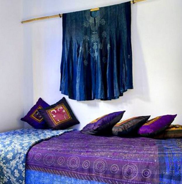 Moroccan Style bedroom with Sapphire Blue and Violet Purple bedding.  Plus striking peacock blue accents!