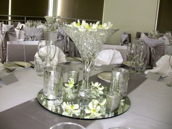 Dress goblet glasses for a wedding table decoration hire for Wedding dress vase centerpiece