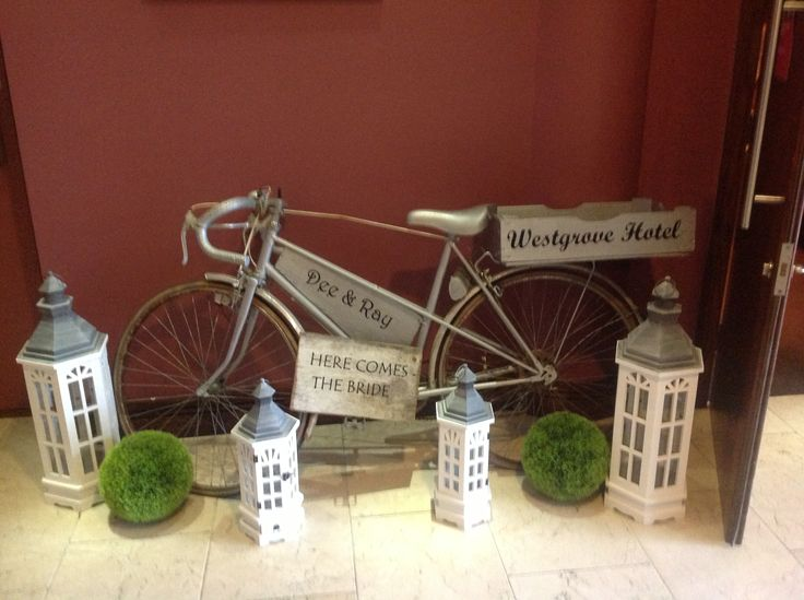 This old bike and lanterns are some of the props available when you let RKD Floral Displays set up your civil wedding ceremony