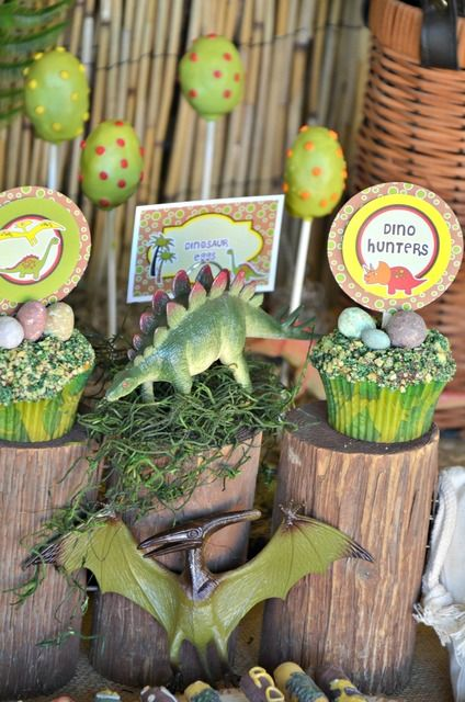 "Cupcakes and cake pops at a Dinosaur Party (love the ""rocks""!) #dinosaur #cupcakes"