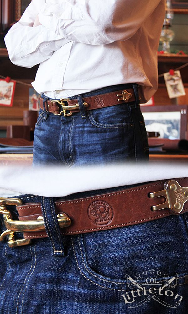 The Col. Littleton No. 5 Cinch Belt in American Buffalo Leather. An adjustable belt that exudes ruggedness, adventure and Americana all in one. What makes this belt so unique is its lever-action buckling mechanism, which gives it a snug fit and a style th