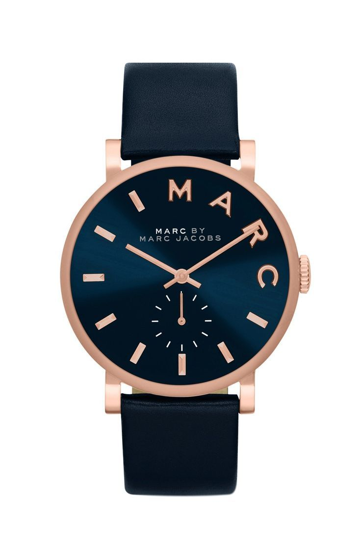 Charmed by the contrast of this stunning Marc Jacobs watch. The deep navy blue against gold accents is enough to catch the eye, while still staying simple and sophisticated.