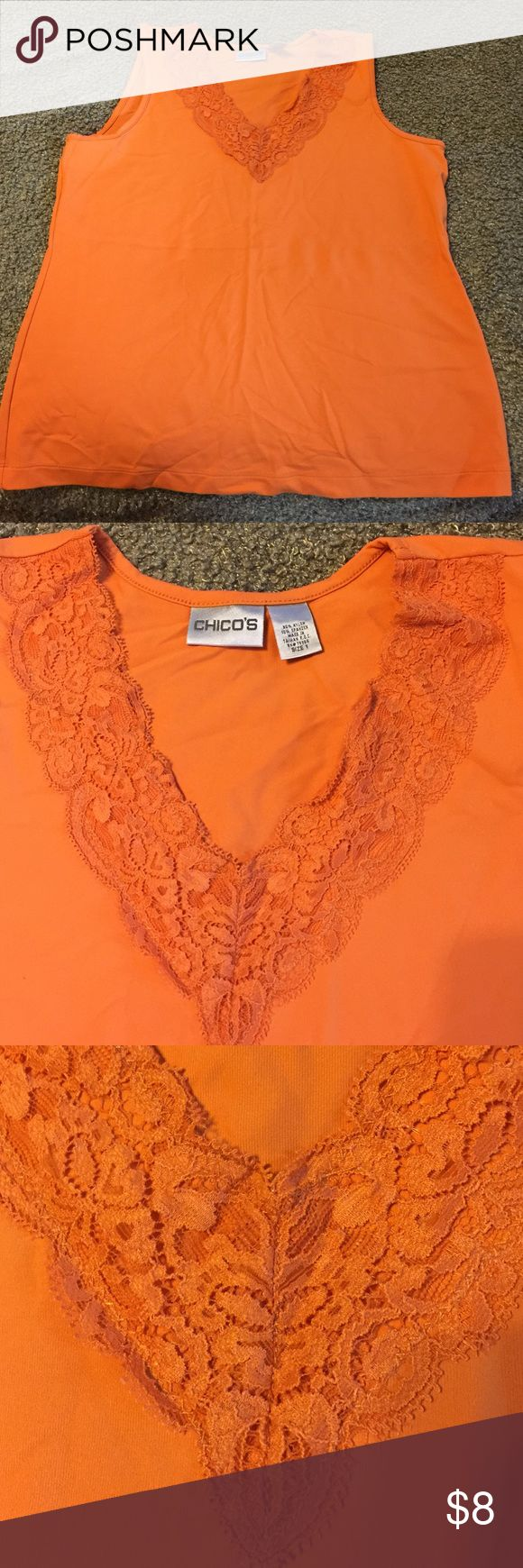Chico's sleeveless top Soft and silky with lace surrounding the vneck!  Adorable!  Chico's size 1. Chico's Tops Camisoles