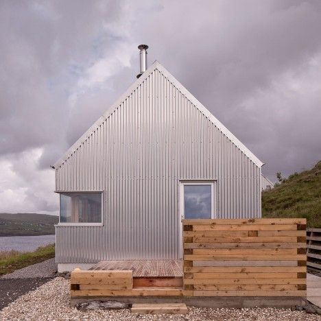 Rural Scottish retreat features corrugated aluminium walls that reference local agricultural buildings