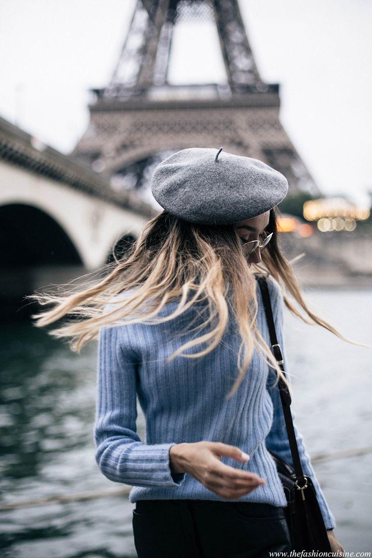 Tumblr photo fashion blogger Beatrice Gutu in Paris wearing a grey beret near Eiffel Tower