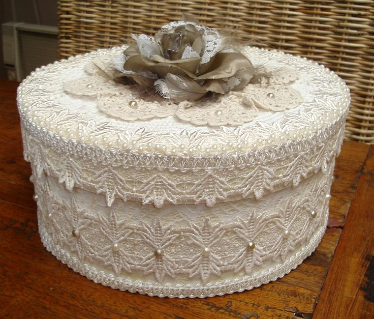 Box coverd in lace and a doily on top