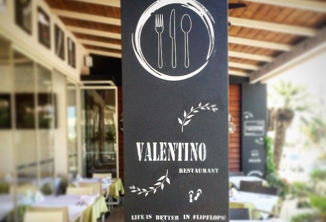 Valentino Pasta & Grill Logo Entrance Interior, exterior design, wall art, chalk wall, painted,  Life is better in flip flops Vitamin Sea, welcome, restaurant, hotel Oscar Suites & Village,