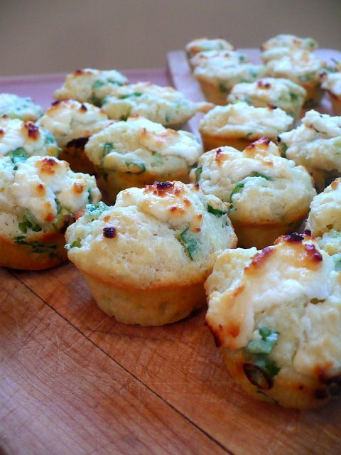 savory goat cheese and green onion mini muffins. So easy to make and slightly addictive. It's a simple muffin recipe with a blob of melting goat cheese in it which makes them savory, tangy, and a little bit sweet at the same time.