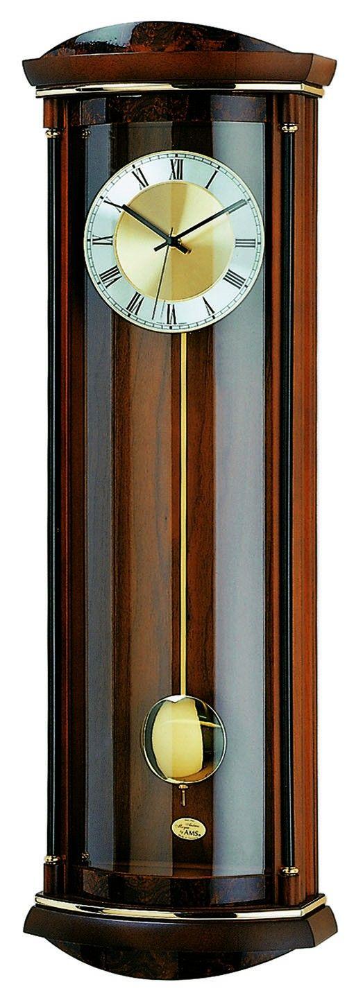 AMS Wandklok Notenhout en wortelnoten Radiogestuurd 5080-1. Een prachtig vormgegeven noten- en wortelnotenhout klok. Het uurwerk is van het radiogestuurde soort. Dankzij een signaal die de klok een paar keer per dag bereikt loopt de klok altijd op de seconde gelijk. De klok heeft een Westminster/bim-bam slag met automatische nachtstand. De slag kan naar keuze ingesteld worden. Deze klok wordt geleverd met batterij. https://www.timefortrends.nl/wekkers-klokken/ams-klokken.html