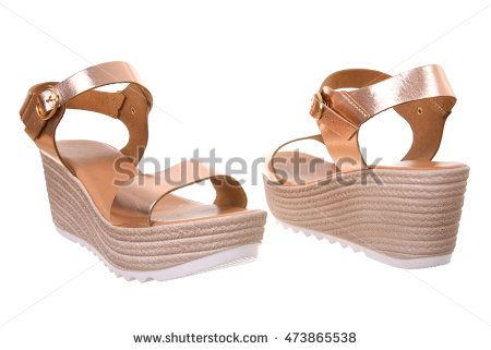 Pair of woman platform sandals isolated on white background