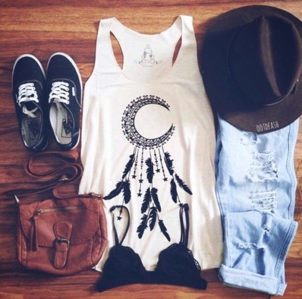 Long White Singlet Tee with Bohemian Style Art Design, a Black Crop Bra, Shredded Jeans, Brown Leather Handbag, Black Brimmed Hat, and a Pair of Classic Black and White Vans Originals - http://ninjacosmico.com/22-beautiful-boho-chic-outfits-try/