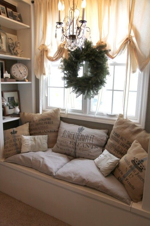 I like how they put all the quote pillows in one place, that way they aren't taking over the whole room. Also love the bookcases next to the window seat