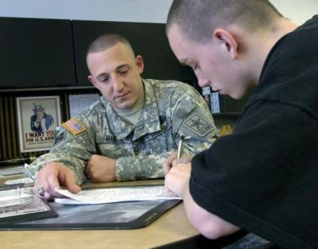 A US Army recruiter speaks with an near-veteran hoping to eventually convert him into full-veteran status.