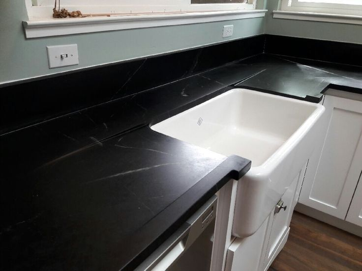 What's better than one Drainboard? How about two! One on each side in this PA Soapstone Kitchen with an farmstyle sink.