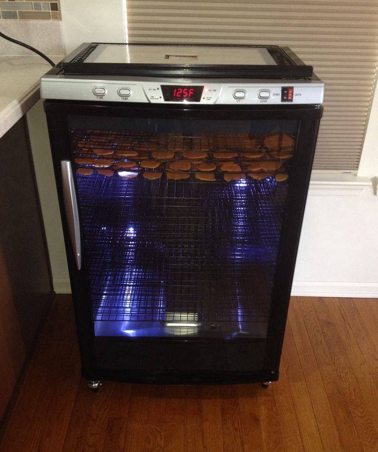My new Cabelas Commercial Dehydrator with a few trays of sweet potato slices.
