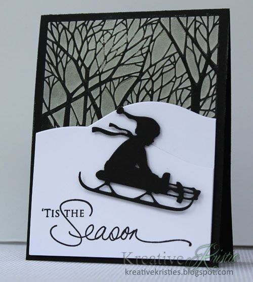 handmade Christmas card from Kreative Kristie ... luv the crisp lines and movement in the card ... black and white ... background trees done in embossing paste through a stencil ... die cut child on sled ... beautiful mixed font with script sentiment ...
