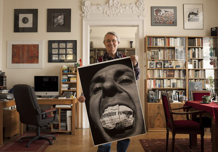 Haris László - Famous hungarian photographers posing with their most iconic works.