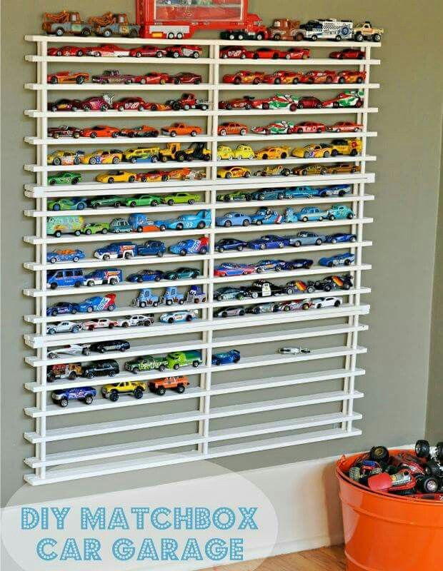 Country Living magazine showed this cute way to store matchbox cars. Love it!