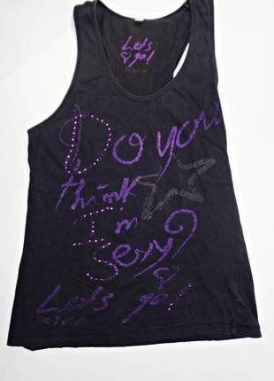 Camiseta de tirantes en color negro y mensaje en color morado. Es la opción perfecta para hacer deporte tanto en la calle como en el gimnasio.  Compra mi artículo en #vinted http://www.vinted.es/ropa-de-mujer/camisetas-sin-mangas-de-tirantes-con-espalda-cruzada/362706-camiseta-tirantes-negra-de-inside-m