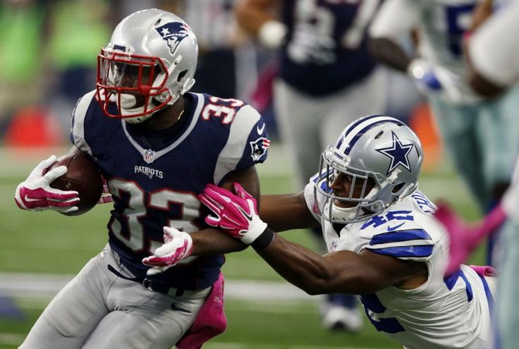 New England Patriots running back Dion Lewis (33) gets a first down, but is tackled by Dallas Cowboys strong safety Barry Church (42) during the first half of an NFL football game on Sunday, October 11, 2015. (John F. Rhodes / Special Contributor) Share This Photo On...