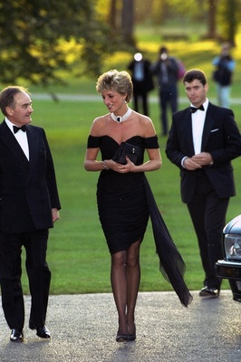 """Princess Diana's """"Revenge"""" dress was by Christina Stambolian, and was purchased for a Vanity Fair dinner at the Serpentine Gallery. The black silk dress had an asymmetrical bodice and came to be known as the """"revenge"""" dress because she wore it on the same day her ex-husband, Prince Charles, admitted to marital infidelities. The dress sold at the Christie's auction in 1997."""