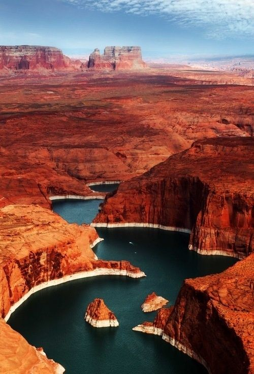 Lake Powell - The 186-mile long lake offers sandy beaches, cool blue water, and exceptional red-rock scenery.