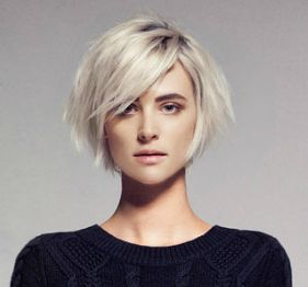 Nice chin length bob with those long side swept bangs that I can never hang in long enough to grow! Love the platinum color.