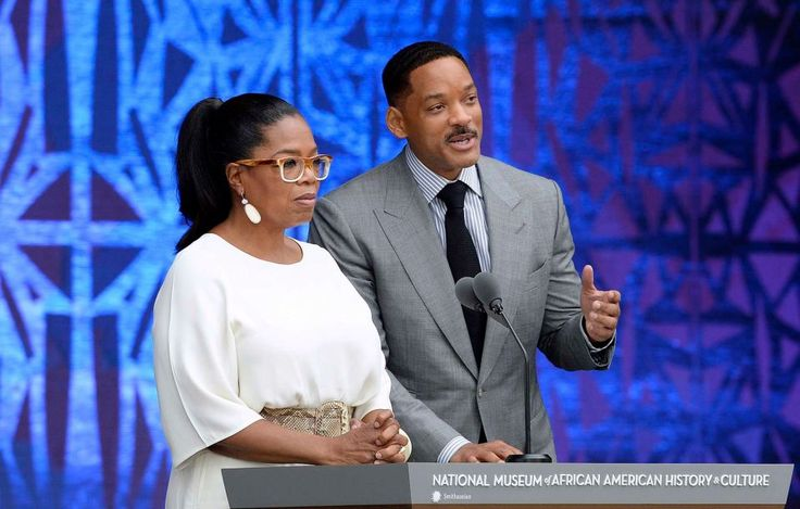 epa05554597 US entertainer Oprah Winfrey (L) and actor Will Smith speak at the opening ceremony  of the Smithsonian's National Museum of African American History and Culture in Washington, DC, USA, 24 September 2016. The opening ceremonies of the 400,000-square-foot museum attracted thousands of attendees.  EPA/OLIVIER DOULIERY / POOL