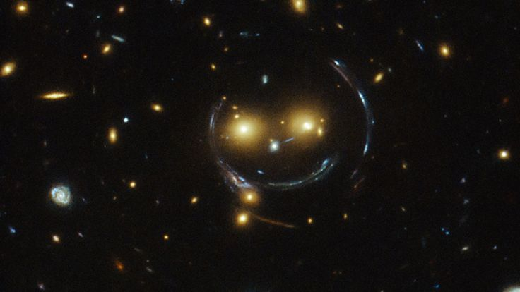 NASA's just taken the best accidental smiley photo ever. It's galaxy cluster SDSS J1038+4849, and it's got one hell of a creepy grin.