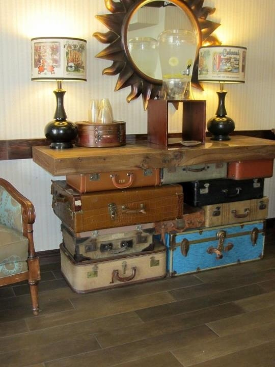 Clever idea using old trunks and suitcases. Saw this in a hotel in Oakland,  CA.we have the trunks and suitcases.