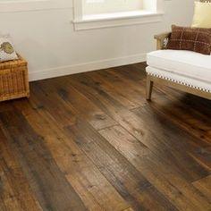 LVT flooring. Luxury Vinyl Tile. Looks like wood, but it's vinyl. For kitchen/great room if it is more cost effective. mediterranean wood flooring by CheaperFloors