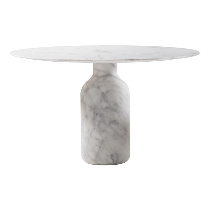 Realized completely in Calacatta white marble or Marquinia one, The Bottle Table is timelessly charming like the marble temples by the rivers of India. A series of dining tables by Edward Barber and Jay Osgerby for Cappellini which won the Wallpaper Design Awards for the best table in 2007.