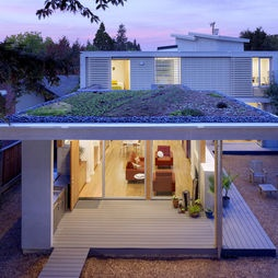 Build a home extension with a flat roof and install flat roof windows to enjoy the benefits of fresh air and daylight. Create access to the top of the roof for a roof top garden to spend balmy summer nights on top of. #GreenRoof