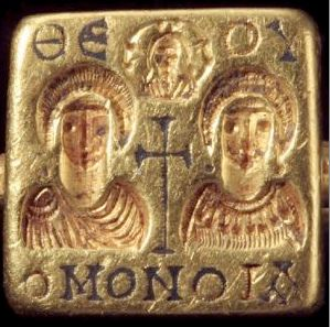 """Gold marriage rings.  Byzantine.  6th century  The wedded couple is blessed by the engraved cross in between the couple on the ring, as well as the bust of Christ above them.  The Greek inscription means """"harmony of God."""""""
