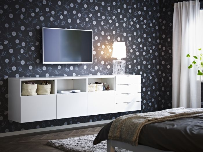 hang a flat screen tv in your bedroom above a chest of drawers or wall unit like best to make it look like a part of the rooms decor - Bedroom Storage Units For Walls