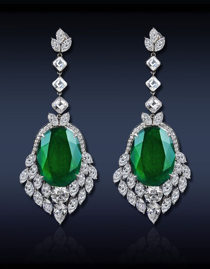 A Breathtaking Drop Emerald Earrings, Featuring: GRS Certified 30.48 Ct Oval Cut Colombian Emeralds (2 Stones), Surmounted by GIA Certified 1.02 Ct D VS2 and 1.00 Ct G VVS1 Round Brilliant Cut Diamonds (2 Stones) Surrounded by 12.53 Ct Mixed Cut Diamonds, All Set in Platinum.