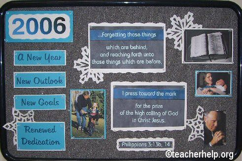 A New Year bulletin board with Philippians 3:13b, 14 on it. All parts of this board can be downloaded from teacherhelp.org. The year has been changed to 2014 on parts to be downloaded.
