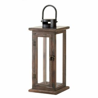$39.95 - Wood, metal and glass combine to create the ideal candle lantern, with a design that is equally familiar and fantastic.