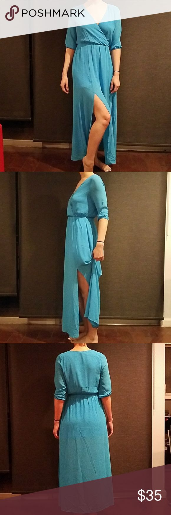 DOUBLE SLIT MAXI DRESS DOUBLE SLIT MAXI DRESS  COLOR LIGHT TURQUOISE  DEEP V NECK  ELASTIC WAIST  FULLY LINED  3/4 LENGTH SLEEVE Dresses Maxi