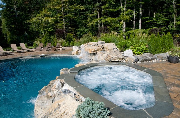 Naturalistic spa overlooking the pool awesome inground for Swimming pool design xls