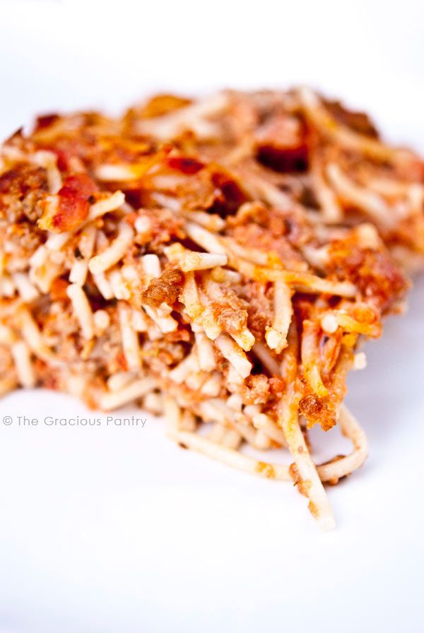 This Clean Eating Spaghetti Pie recipe will make everyone happy at the dinner table! Enjoy this and over 1000 clean eating recipes at TheGraciousPantry.com!