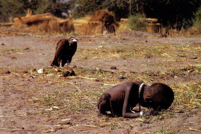 Vulture stalking a child - Kevin Carter 1993. Carter won the Pulitzer Prize for this photograph but faced criticism for not helping the child. Consumed with the violence he'd witnessed, and haunted by the questions as to the little girl's fate, he committed suicide three months later.