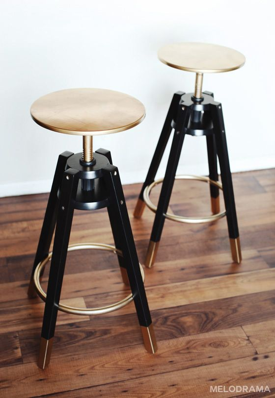 """This is a picture of DALFRED's Ikea bar stool makeover. I love the black and gold detail, though I think I prefer the seats black with gold details rather than all gold. Other than that, I think it's perfect! It's glamorous, but not attention-grabbing. It's modern, chic, sexy, and low-key. My only concern is that it does not seem comforting or """"cushy"""" enough, but I think this is alright because this is more of a space-saver idea."""