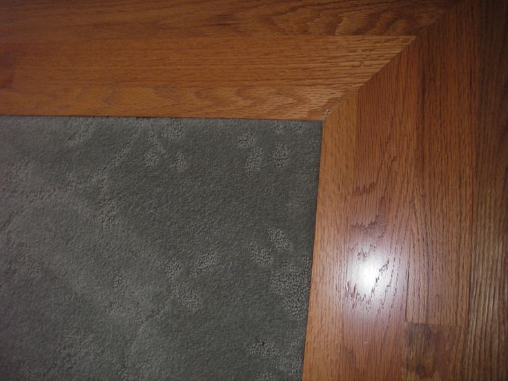 Carpet Inlay Wood Floor Bordering 3 Feet Around Room Wall