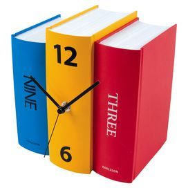 Complete your eclectic living room scheme with this colourful clock, featuring a stacked book silhouette that would slot easily into your bookcase. Match with vibrant art work for a modern look.  Product: Book clockConstruction Material: Paper and plasticColour: Red, blue and yellowFeatures: Designed by Sjoerd van HeumenAccommodates: (1) AA battery - not includedDimensions: 20 cm H x 20 cm W x 15 cm D