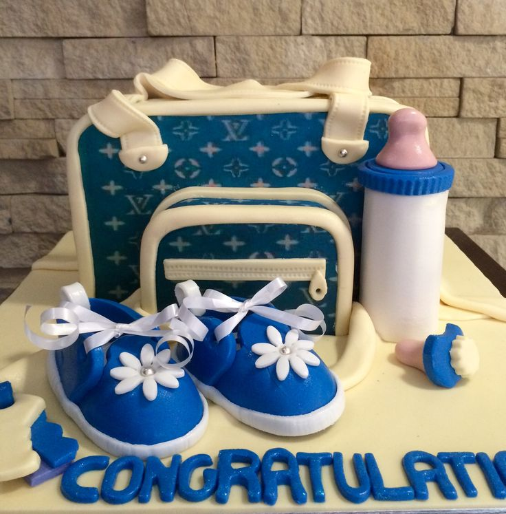 Baby bag cake in blue and yellow