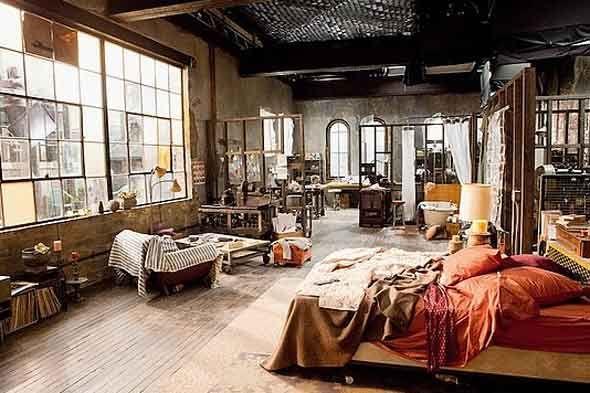 artsy studio. i love the bright bed.                                                                                                                                                                                 More
