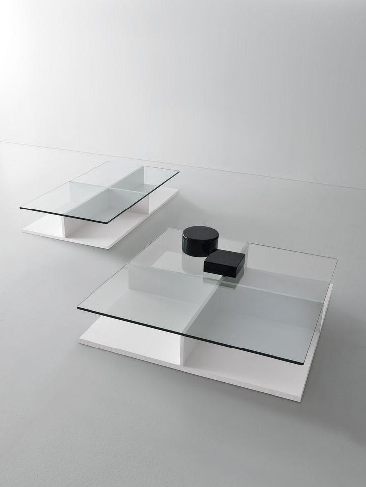 Bianco candido lacquered Brio coffee tables with clear glass tops.__ Tavolini Brio laccato bianco candido con piano in vetro trasparente.