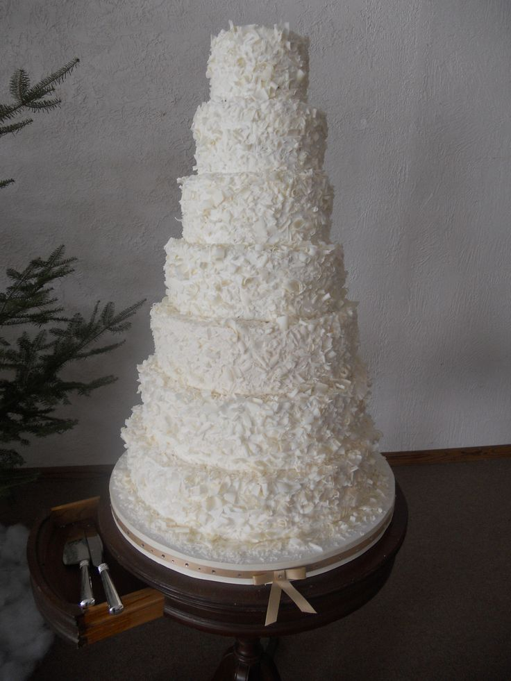 7 Tiered Wedding Cake - This is a  7 tiered wedding cake.  The bride saw this cake in Martha Stewart Wedding Cakes and wanted it  - but doesn't like coconut.  So this is covered in white chocolate shavings with off-white buttercream.